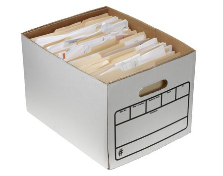 Storage box filled with documents in manila folders shot on white background