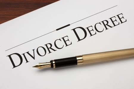 divorce court: Divorce decree and gold fountain pen shot on warm wood surface