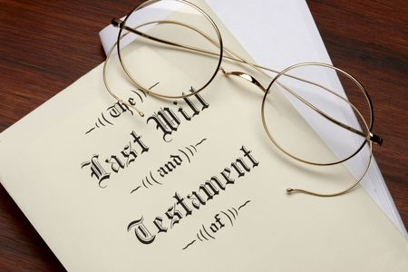 testament: Last will and testament, wire rim glasses shot on warm wood surface Stock Photo