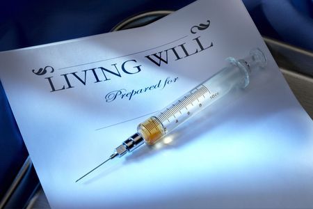 Copy of living will shot with injectable lethal dose on stainless steel hospital tray