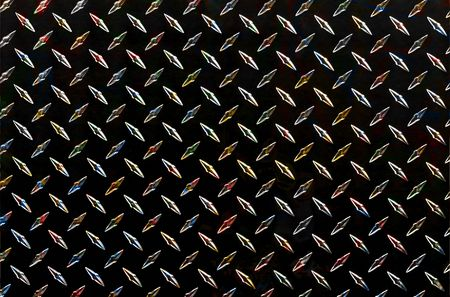 metal textures: sheet of diamond plate with multi-color texture Stock Photo