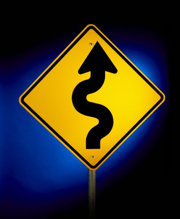 Yellow road sign shot on blue glowing background warning of curvy road ahead photo
