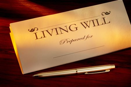 testament: Living Will with gold pen shot on warm wood desk