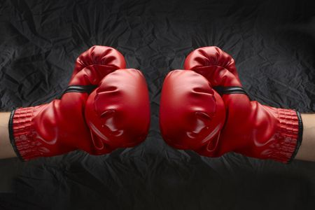 equipment: Two boxers touch gloves ready to start fight
