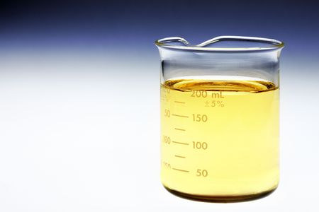 Glass beaker of bio fuel shot on light box with room for copy