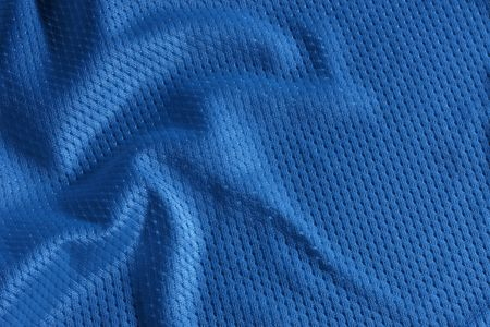 Close up shot of blue textured football jersey photo