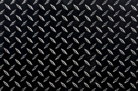 Sheet of black diamond plate with highlighted texture Archivio Fotografico