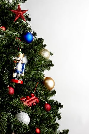 close up of christmas tree with colorful ornaments shot on white background with copy space Stock Photo - 5917059