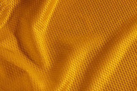 Close up shot of orange textured football jersey photo