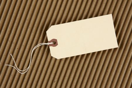 Blank hang tag with space for copy shot on corrugated cardboard Imagens