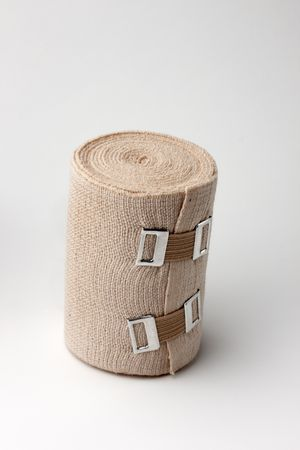 close up of roll of ace bandage with clips