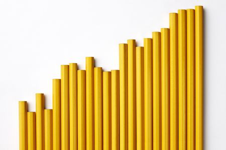 Group of pencils shot to look like a bar graph on white with soft shadow and space for copy Stock Photo