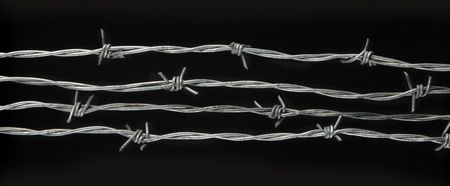 4 lengths of barbed wire shot on black background Stock Photo - 6231198