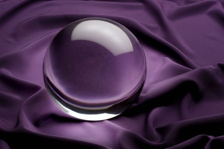 glowing crystal ball shot on purple satin