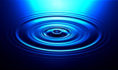Drip causes ripple in water with concentric circles Stock Photo