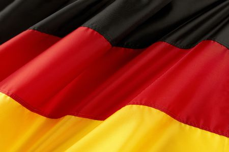 flag germany: Close up shot of colorful, wavy German flag Stock Photo