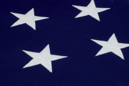 sewn up: Close up shot of 4 hand sewn stars on an American flag