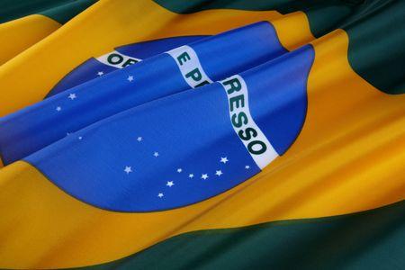 Macro shot of wavy, colorful flag of Brazil