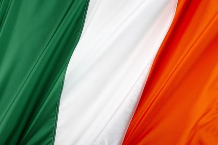 Close up shot of wavy, colorful Irish flag