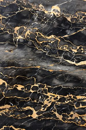 Dark gray and black marble with golden veins fill frame