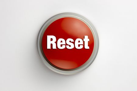 Red reset button shot on white background with soft shadow