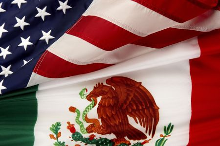 Close-up shot of the Mexican and American flags