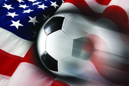 Soccer ball streaks across flag of United States Stock Photo