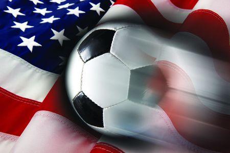 Soccer ball streaks across flag of United States Stok Fotoğraf