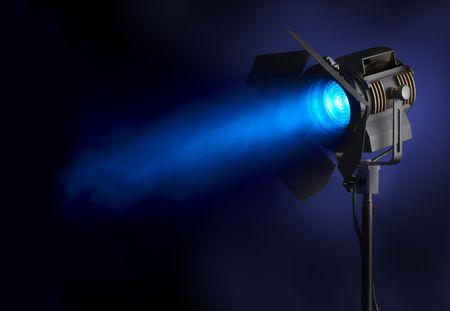 spotlight: Spotlight shines blue beam of light through smoke, with space for copy
