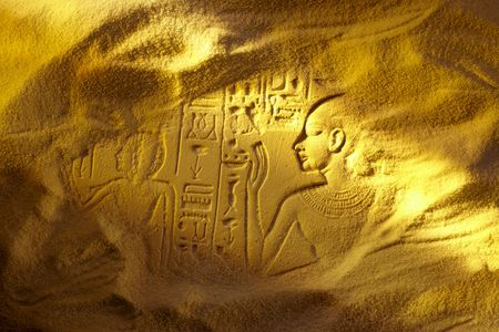 Ancient Egyptian hieroglyphs uncovered in the sandy desert Фото со стока