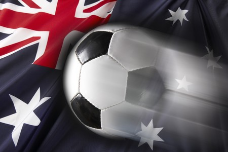 streaks: Soccer ball streaks across flag of Australia
