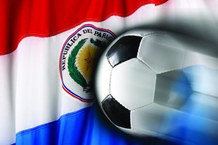 Soccer ball streaks across wavy flag of Paraguay photo