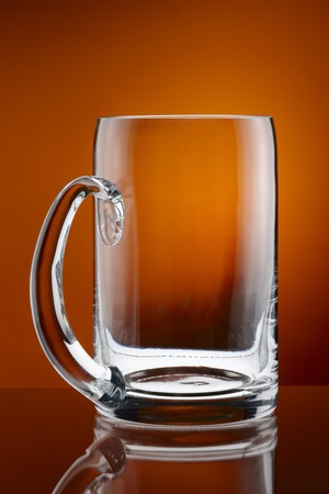 close up of empty beer mug shot on deep, rich amber background Stock Photo - 7038481