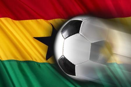 streaks: Soccer ball streaks across way flag of Ghana Stock Photo