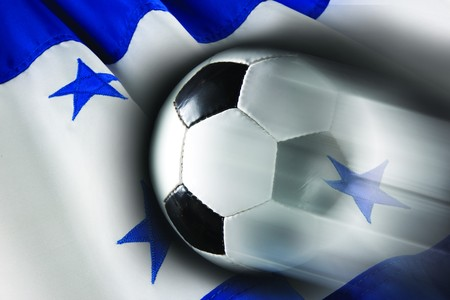 Soccer ball streaks across wavy flag of Honduras photo