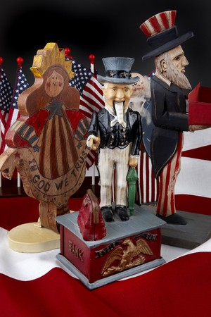 Antique figurines of Uncle Sam shot on the red and white stripes of the American flag photo