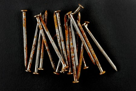Closeup shot of several rusty nails shot on black background with space for copy Reklamní fotografie