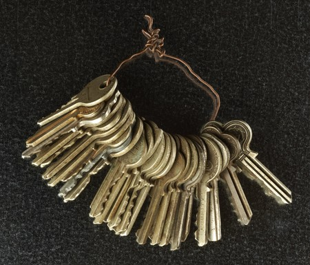 Several keys held together by copper wire on matallic background