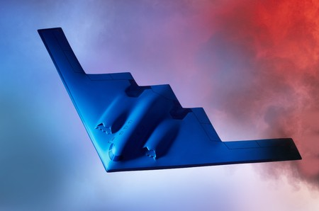 bomber: Oncoming Stealth B-2 Bomber shot against a blue orange sky with room for copy