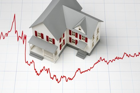 Model of house shot on graph depicting mortgage rates photo