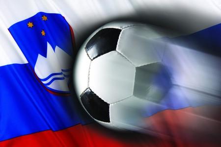 Soccer ball streaks across wavy Slovenian flag