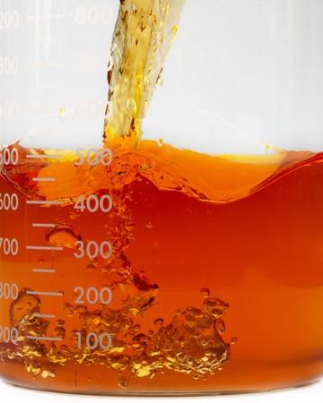 close up shot of bio fuel pouring into a beaker