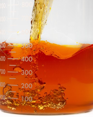 close up shot of bio fuel pouring into a beaker