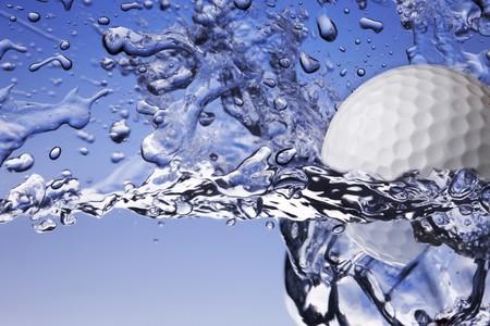 close up shot of golf ball splashing into water