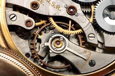 Disparo de macro del mecanismo de un reloj de bolsillo de antigüedades  Foto de archivo