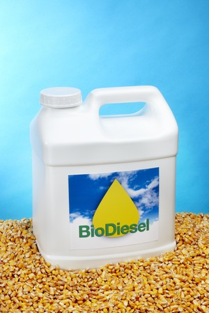 White plastic container of biodiesel shot on golden corn with sky blue background and space for copy Reklamní fotografie - 7818694