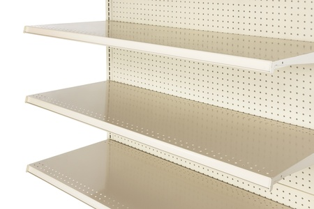 Close-up of empty retail store shelf shot in studio and silhouetted