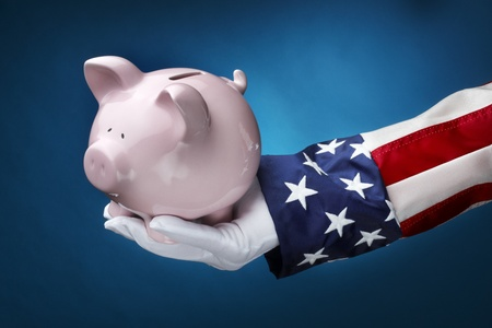 Close up shot of Uncle Sam holding pink piggy bank