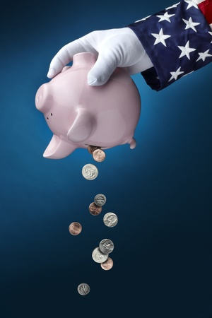 Close up shot of Uncle Sam emptying out coins from pink Piggy Bank