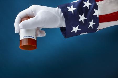 Close up shot of Uncle Sam holding empty bottle of  prescription drugs photo